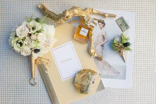 small-white-and-gold-bouquet-with-coco-chanel-items-journal-picture-perfume-branch-emblem