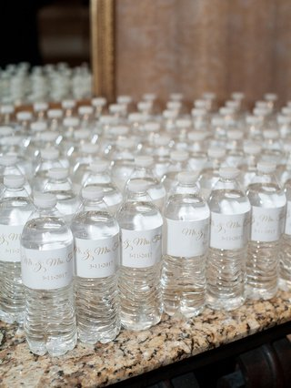 wedding-favors-personalized-water-bottles-to-pass-out-on-dance-floor-white-gold-custom-label