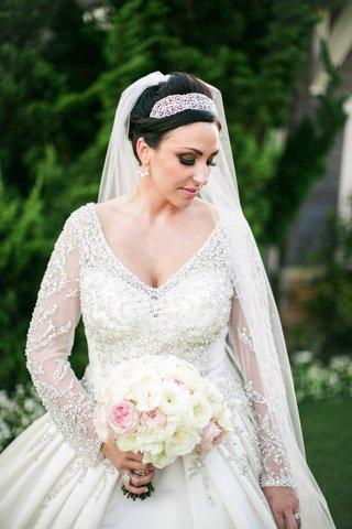 bride-wearing-beaded-bodice-wedding-dress-with-long-sleeves