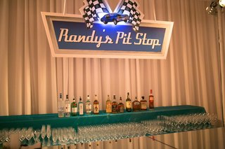 mens-bar-area-at-wedding-styled-to-look-like-nascar
