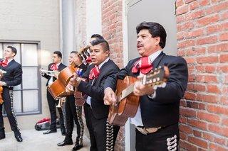 wedding-ceremony-outdoor-mariachi-band-in-uniform-brick-wall-performing-outdoors-urban-venue