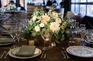 wood-table-gold-candle-votives-small-low-centerpiece-eucalyptus-leaves-scabiosa-pods-white-flower