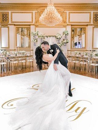 wedding-reception-ballroom-white-gold-dance-floor-dip-kiss-husband-and-wife-wedding