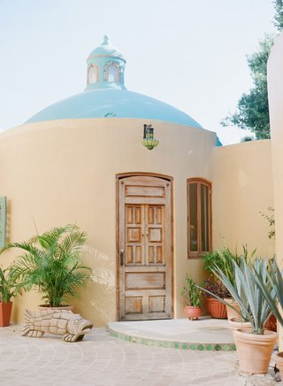 wedding-venue-destination-wedding-in-riviera-nayarit-mexico-wood-door-adobe-spanish-style-building