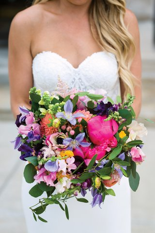 vibrant-bridal-bouquet-with-bright-pink-peonies-flowers-in-purple-peach-and-yellow