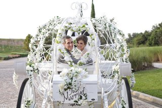 horse-drawn-buggy-with-flowers-and-just-married-sign