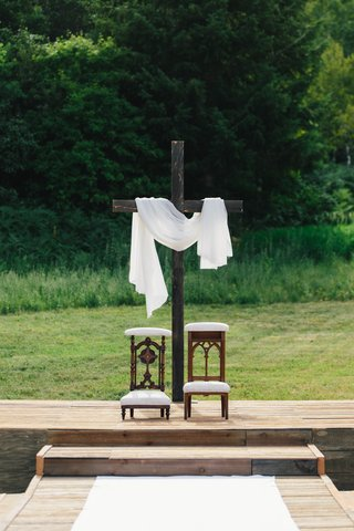 cross-at-altar-for-wedding-ceremony-antique-kneeler-from-church-at-front-of-ceremony