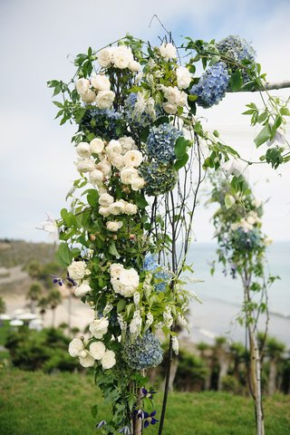 outdoor-wedding-ceremony-structure-with-branches-and-flowers