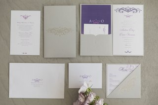styled-shoot-with-white-purple-silver-inivtation-suite-purple-script-and-motif-folder-menu-card