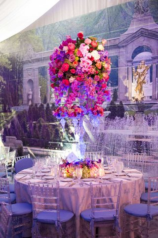 wedding-reception-table-with-crystal-candelabra-and-colorful-orchids-and-roses