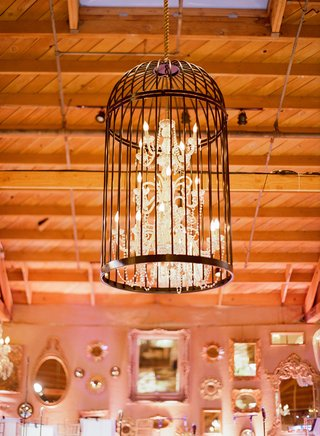wedding-lighting-chandelier-inside-bird-cage-at-reception