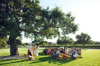 wedding-ceremony-under-tree-at-firestone-wine