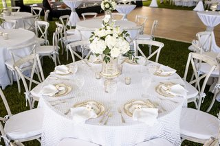mercury-glass-vases-white-flowers-geometric-linens-silver-place-settings-grey-wooden-chairs