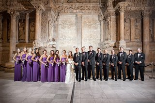 bridesmaids-in-purple-dresses-and-groomsmen-in-tuxes