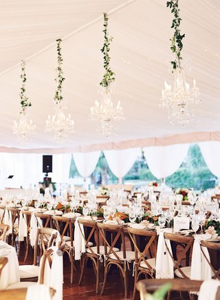 wedding-head-table-wood-x-back-chairs-white-linens-magnolia-leaves-greenery-crystal-chandeliers
