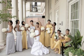 bride-in-mermaid-gown-with-nine-gold-and-silver-bridesmaid-dresses