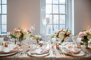 sequin-tablecloths-topped-with-short-floral-arrangements