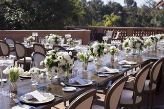 long-farm-tables-linen-chairs-white-florals-intimate-luncheon-reception