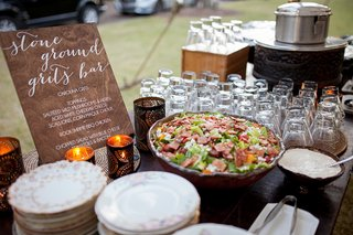 stone-ground-grits-bar-at-southern-south-carolina-wedding-outdoor-reception-buffet-station