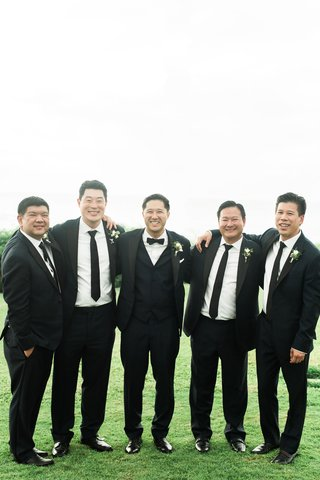 destination-wedding-hawaii-groomsmen-groom-in-vest-bow-tie-groomsmen-in-black-suits-ties