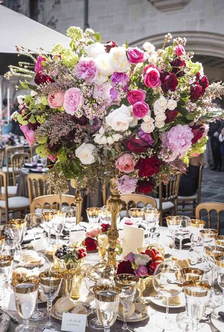 tall-flower-arrangement-with-pink-flowers-on-gold-candelabra