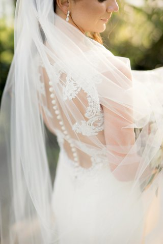 veil-over-semi-illusion-back-gown-wedding-buttons-lace-details