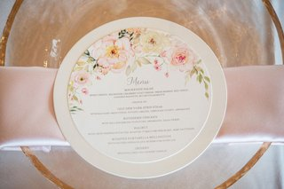 wedding-reception-menu-with-floral-details-and-a-circle-shape
