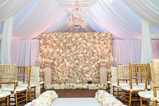 chapel-with-white-drapery-flower-wall-chandelier-gold-chiavari-chairs-at-tracy-morgan-wedding