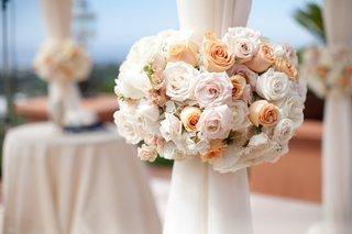 orange-and-pink-roses-around-chuppah-pillars