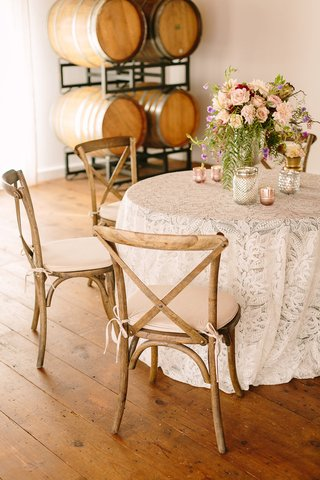 small-table-lace-linen-votives-florals-faux-wedding-party-styled-shoot-rustic-event-wood-barrels