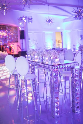 wedding-after-party-mid-century-sputnik-lighting-chandeliers-mirror-cocktail-bar-table-white-stools