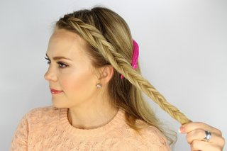 bride-doing-her-own-braid-for-wedding-day-hairstyle