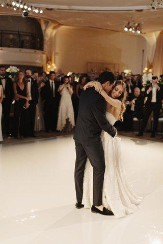 bride-in-strapless-wedding-dress-naeem-khan-groom-in-loafers-tuxedo-first-dance-white-dance-floor