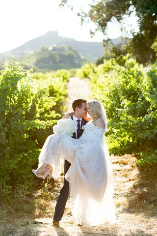bride-in-pallas-couture-gown-with-blush-nude-lining-groom-in-navy-burberry-suit-in-vineyard
