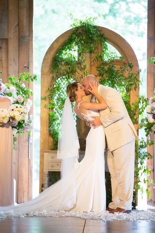 new-york-jets-brian-winters-wedding-groom-in-tan-suit-bride-in-pronovias-wedding-dress-kiss
