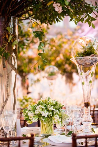 wedding-table-decorations-with-rocks-leaves-branches