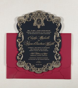 red-scallop-envelope-with-black-invitation-gold-crest-and-design-around-border-of-invitation-wedding