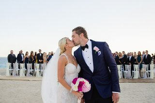 sheldon-souray-and-barbie-blank-kiss-at-end-of-aisle-after-wedding-ceremony-on-the-beach-in-mexico