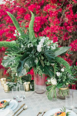 rustic-floral-arrangement-of-greenery-maiden-hair-monstera-leaves-foliage-boho-table-wedding