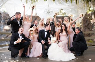 bridesmaids-in-amsale-bride-in-vera-wang-bridal-party-celebrates-as-newlyweds-kiss