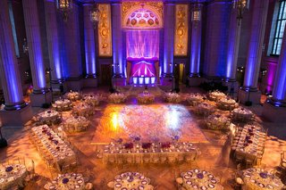 andrew-w-mellon-auditorium-wedding-with-blue-and-purple-uplighting