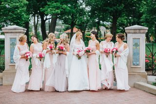 bride-in-custom-a-line-gown-bridesmaids-in-mismatched-blush-dresses-bridesmaids-with-pashminas