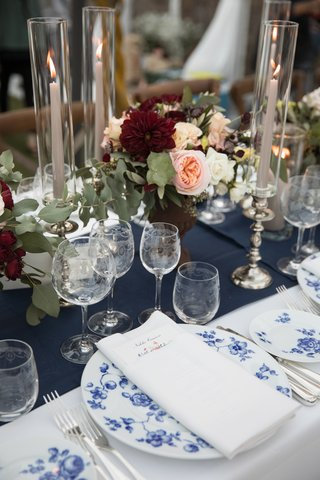 wedding-reception-table-with-blue-floral-china-pattern-navy-table-runner-marsala-and-blush-florals