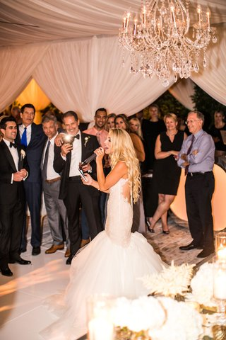 bride-in-mermaid-dress-by-galia-lahav-singing-at-reception-as-guests-take-photos-on-their-phones
