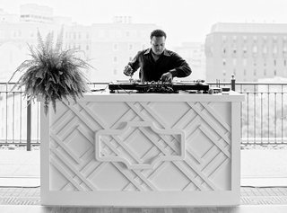 black-and-white-photo-of-dj-with-washington-dc-buildings-in-background