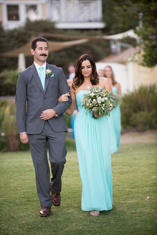 bridesmaid-and-groomsmen-in-baby-blue-dress-and-tie-beach-wedding