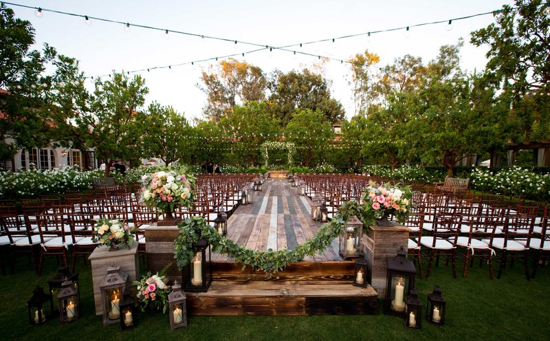 wedding ceremony aisle decorations wood raised stage outdoor ceremony