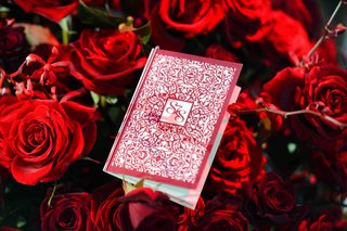 white-and-red-intricate-design-on-hardcover-program