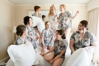 bride-and-bridesmaids-in-matching-pajamas-bridesmaid-pillow-fight-during-getting-ready