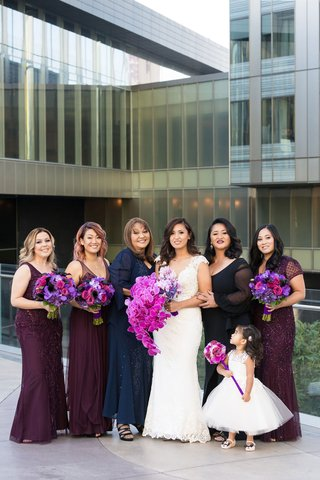 bride-in-cristiano-lucci-wedding-dress-bridesmaids-in-plum-dresses-mother-of-the-bride-flower-gir